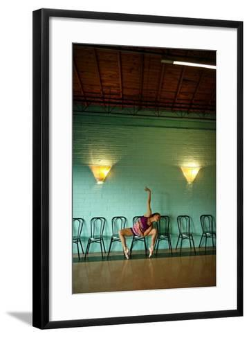 A Professional Dancer Warms Up For Her Daily Ballet Routine-Kike Calvo-Framed Art Print