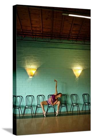 A Professional Dancer Warms Up For Her Daily Ballet Routine-Kike Calvo-Stretched Canvas Print
