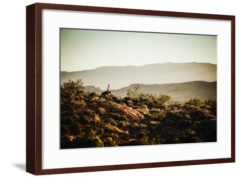 A Woman Practices Yoga In The Red Cliffs Desert Reserve, Saint George, Utah-Louis Arevalo-Framed Art Print
