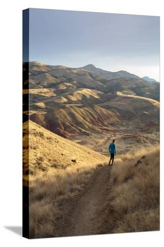 Bekah Herndon Hiking Along Carroll Rim Trail, John Day Fossil Beds National Monument Eastern Oregon-Ben Herndon-Stretched Canvas Print