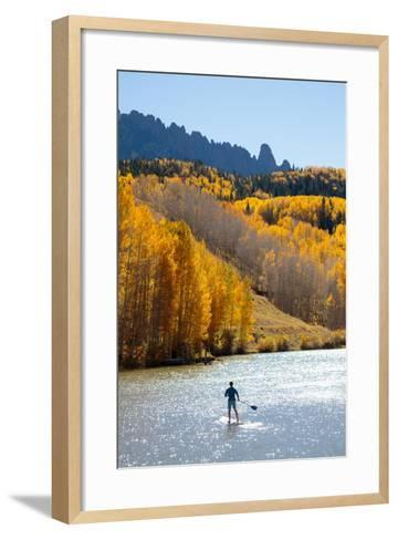 Man Paddle Boarding On Inflatable SUP Boards Near Telluride, Colorado In Autumn In The San Juan Mts-Ben Herndon-Framed Art Print