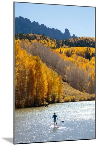 Man Paddle Boarding On Inflatable SUP Boards Near Telluride, Colorado In Autumn In The San Juan Mts-Ben Herndon-Mounted Photographic Print
