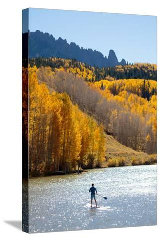 Man Paddle Boarding On Inflatable SUP Boards Near Telluride, Colorado In Autumn In The San Juan Mts-Ben Herndon-Stretched Canvas Print