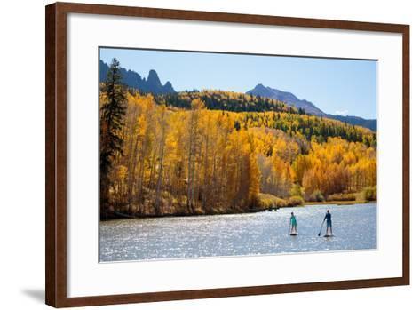 Woman And Man Enjoy Fall Bliss On SUP Boards Near Telluride, Colorado In Autumn, San Juan Mts-Ben Herndon-Framed Art Print
