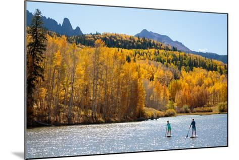 Woman And Man Enjoy Fall Bliss On SUP Boards Near Telluride, Colorado In Autumn, San Juan Mts-Ben Herndon-Mounted Photographic Print