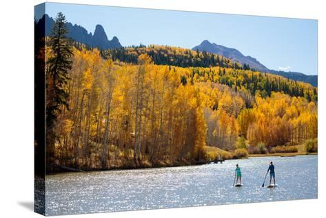 Woman And Man Enjoy Fall Bliss On SUP Boards Near Telluride, Colorado In Autumn, San Juan Mts-Ben Herndon-Stretched Canvas Print