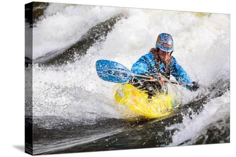 A Female Kayaker Playboating In A Drysuit On Pipeline Wave On The Lochsa River In Idaho-Ben Herndon-Stretched Canvas Print