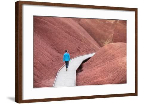 A Female Hiker Takes In The View Of The Beautiful Soil Colors And Textures Along Painted Cove Trail-Ben Herndon-Framed Art Print