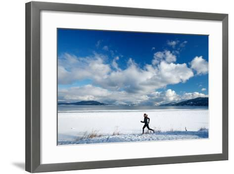 Noelle Zmuda Goes For Winter Run On The Pond Oreille Bay Trail, Sandpoint, Idaho. Lake Pend Oreille-Ben Herndon-Framed Art Print