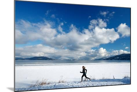 Noelle Zmuda Goes For Winter Run On The Pond Oreille Bay Trail, Sandpoint, Idaho. Lake Pend Oreille-Ben Herndon-Mounted Photographic Print