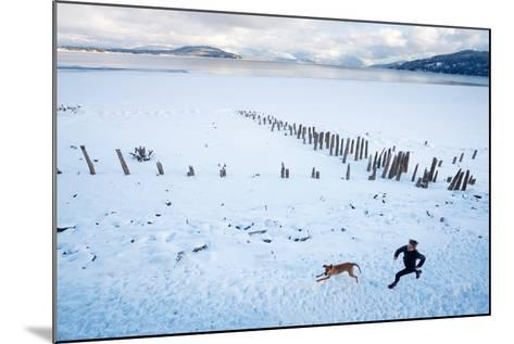 Noelle Zmuda And Her Dog Tink Go For A Cold Winter Run On Pond Oreille Bay Trail, Sandpoint, Idaho-Ben Herndon-Mounted Photographic Print