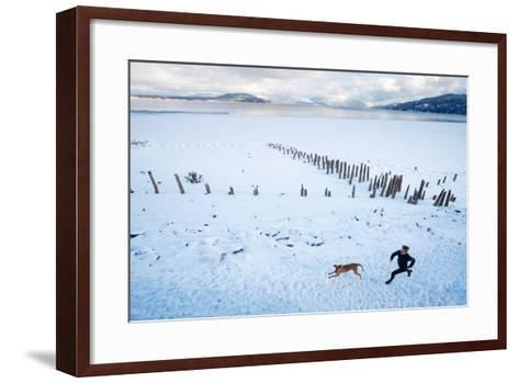 Noelle Zmuda And Her Dog Tink Go For A Cold Winter Run On Pond Oreille Bay Trail, Sandpoint, Idaho-Ben Herndon-Framed Art Print