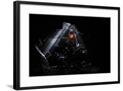 A Man Holding A Propane Lantern Exits The Cheese Cave, A 2,000 Foot Lava Tube-Ben Herndon-Framed Art Print