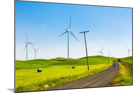 Ian Engerbretson Running Amidst Giant Windmills On A Spring Day In South East Washington State-Ben Herndon-Mounted Photographic Print