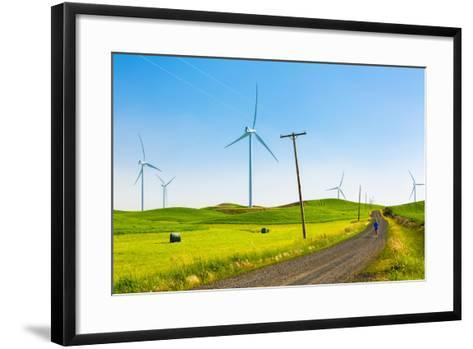 Ian Engerbretson Running Amidst Giant Windmills On A Spring Day In South East Washington State-Ben Herndon-Framed Art Print