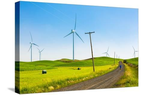 Ian Engerbretson Running Amidst Giant Windmills On A Spring Day In South East Washington State-Ben Herndon-Stretched Canvas Print