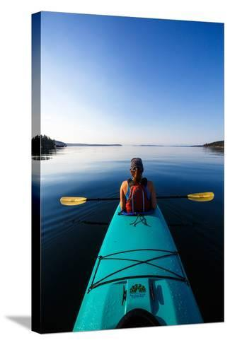 A Female Tandem Kayaker Enjoys The Still Waters Of Indian Cove Off Shaw Islands-Ben Herndon-Stretched Canvas Print