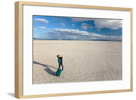 Traveler Rolls A Carry-On Suitcase, The Playa In The Alvord Desert Of SE Oregon-Ben Herndon-Framed Art Print