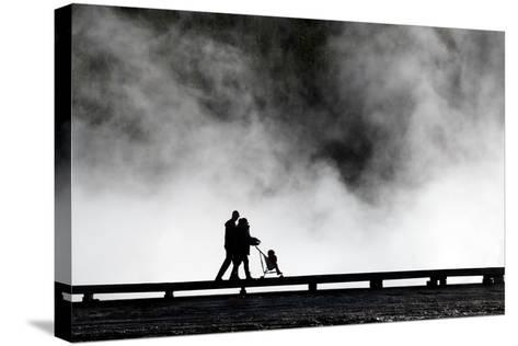 Couple Push Their Baby On Boardwalk At Grand Prismatic Spring In Yellowstone NP In Autumn-Ben Herndon-Stretched Canvas Print