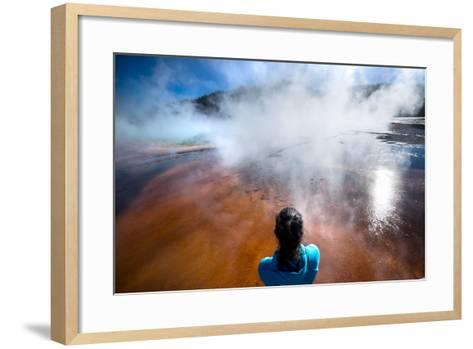 A Woman Takes In The Misty View Of The Grand Prismatic Spring In Yellowstone NP In Autumn-Ben Herndon-Framed Art Print