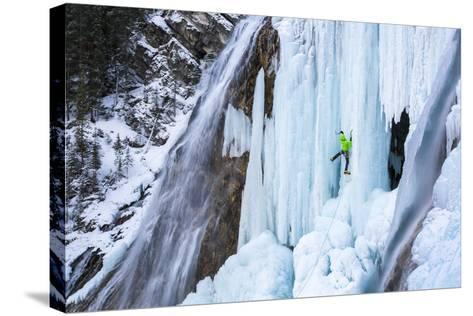 Jess Roskelley Climbing Flowing Waterfalls At The Junkyard, Ice Climbing Crag Near Canmore, Alberta-Ben Herndon-Stretched Canvas Print