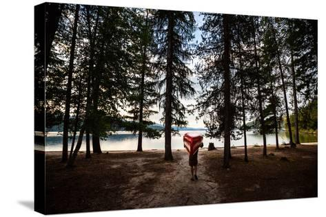 A Man Carrying A Canoe At Priest Lake In North Idaho-Ben Herndon-Stretched Canvas Print