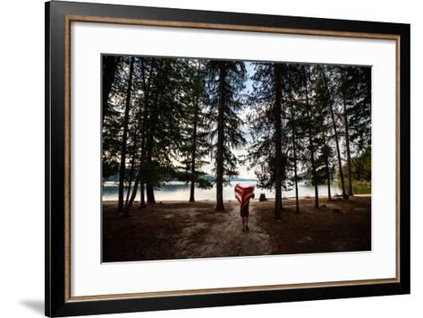 A Man Carrying A Canoe At Priest Lake In North Idaho-Ben Herndon-Framed Art Print