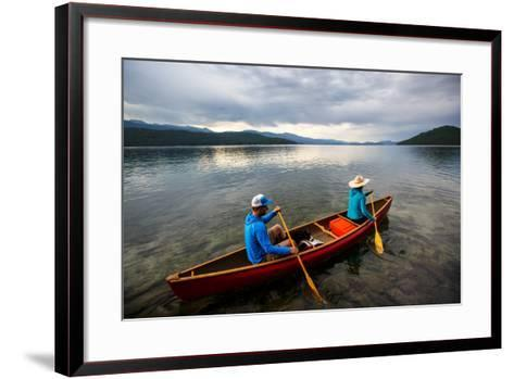 Man & Woman Paddle A Canoe While Shilo The Dog Enjoys The Ride At Sunrise On Priest Lake In N Idaho-Ben Herndon-Framed Art Print