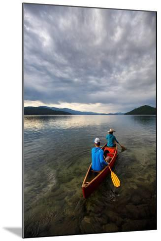 Man & Woman Paddle A Canoe While Shilo The Dog Enjoys The Ride At Sunrise On Priest Lake In N Idaho-Ben Herndon-Mounted Photographic Print