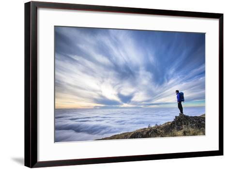 A Female Backpacker Stands On A Rocky Outcrop Above The Clouds At Steptoe Butte, Eastern Washington-Ben Herndon-Framed Art Print