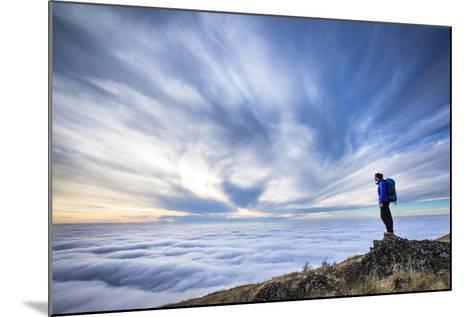 A Female Backpacker Stands On A Rocky Outcrop Above The Clouds At Steptoe Butte, Eastern Washington-Ben Herndon-Mounted Photographic Print