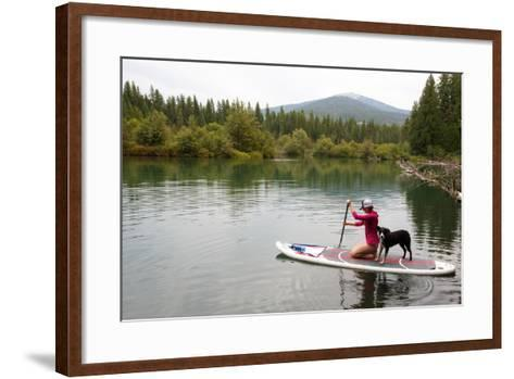 A Woman And Her Dog Shilo On Inflatable SUP Board At The Priest Lake Thoroughfare In North Idaho-Ben Herndon-Framed Art Print
