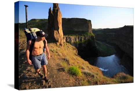 Man Wearing Inflatable SUP Pack Hikes Around Middle Tier At Palouse Falls, Sunset-Ben Herndon-Stretched Canvas Print