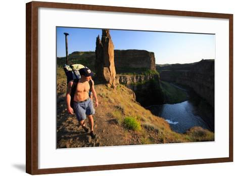 Man Wearing Inflatable SUP Pack Hikes Around Middle Tier At Palouse Falls, Sunset-Ben Herndon-Framed Art Print