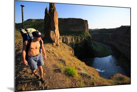 Man Wearing Inflatable SUP Pack Hikes Around Middle Tier At Palouse Falls, Sunset-Ben Herndon-Mounted Photographic Print