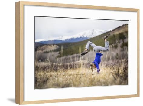 Taryn Pearce Holds A Handstand Yoga Pose Near Kenosha Pass - Colorado-Dan Holz-Framed Art Print