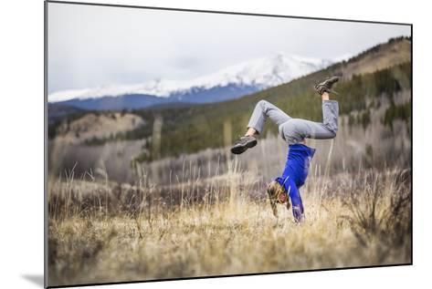 Taryn Pearce Holds A Handstand Yoga Pose Near Kenosha Pass - Colorado-Dan Holz-Mounted Photographic Print