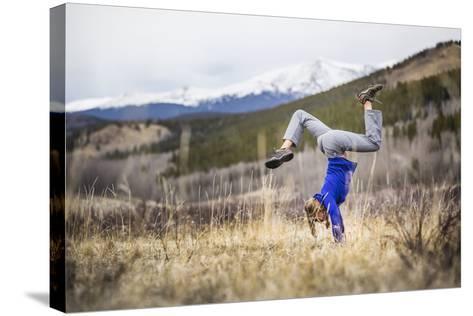 Taryn Pearce Holds A Handstand Yoga Pose Near Kenosha Pass - Colorado-Dan Holz-Stretched Canvas Print