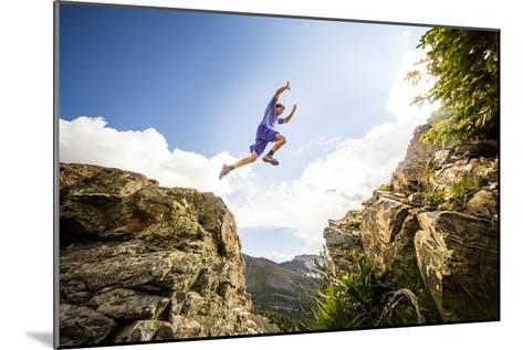 Ben Rueck Catches Some Air During A High Mountain Trail Run Just Outside Marble, CO-Dan Holz-Mounted Photographic Print