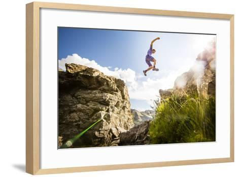 Ben Rueck Catches Some Air During A High Mountain Trail Run Just Outside Marble, CO-Dan Holz-Framed Art Print