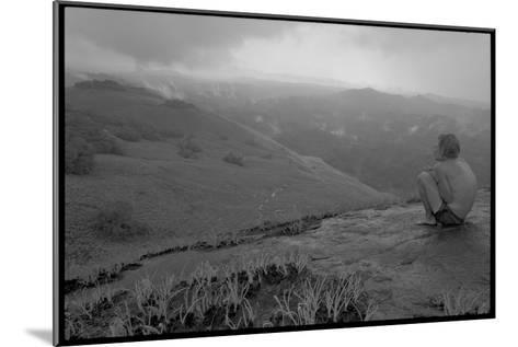 Michael Fay crouches on a mountaintop after nine months in the jungle-Michael Nichols-Mounted Photographic Print