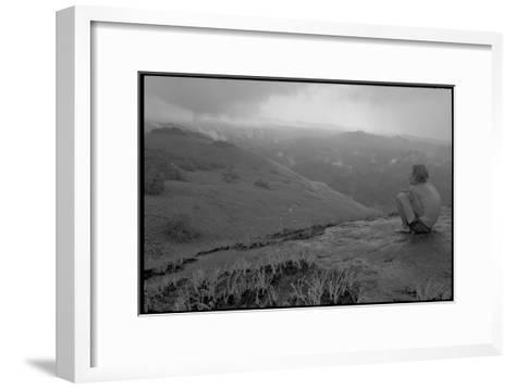 Michael Fay crouches on a mountaintop after nine months in the jungle-Michael Nichols-Framed Art Print