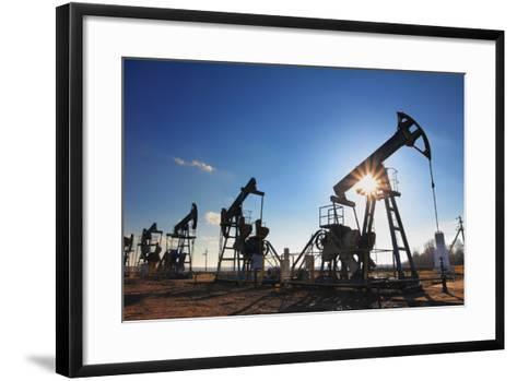 Working Oil Pumps Silhouette against Sun-Kokhanchikov-Framed Art Print
