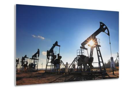 Working Oil Pumps Silhouette against Sun-Kokhanchikov-Metal Print