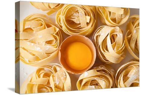 Fettuccine Pasta Italian Food Still Life Rustic Flat Lay White Background Tagliatelle Alfredo Yolk- rukxstockphoto-Stretched Canvas Print