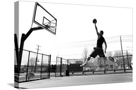 A Young Basketball Player Flying towards the Rim for a Slam Dunk.-ARENA Creative-Stretched Canvas Print