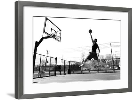 A Young Basketball Player Flying towards the Rim for a Slam Dunk.-ARENA Creative-Framed Art Print