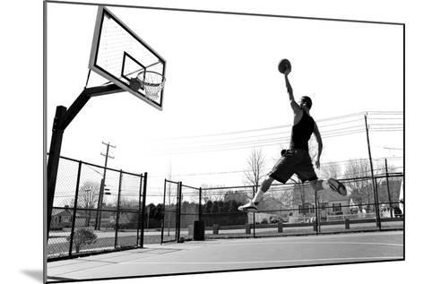 A Young Basketball Player Flying towards the Rim for a Slam Dunk.-ARENA Creative-Mounted Photographic Print