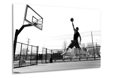 A Young Basketball Player Flying towards the Rim for a Slam Dunk.-ARENA Creative-Metal Print