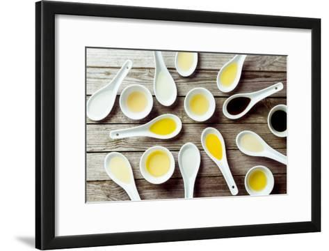 Several Soup Spoons and Sauce Dishes Arranged Randomly on Wooden Surface-stockcreations-Framed Art Print